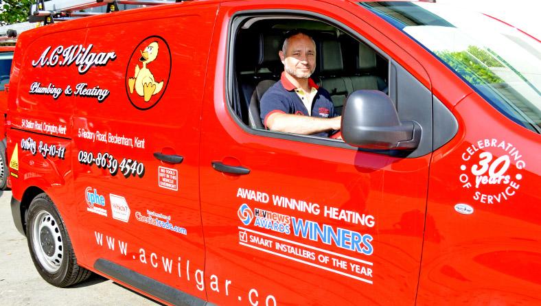 A.C. Wilgar plumber and engineer in his A.C. Wilgar van