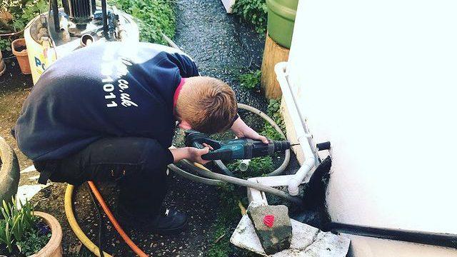 A.C. Wilgar plumber drilling into external wall