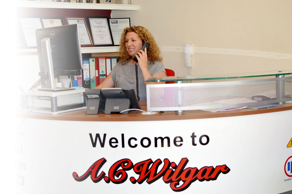 Lisa Hopper the Office Manager at A.C. Wilgar on the phone to a customer