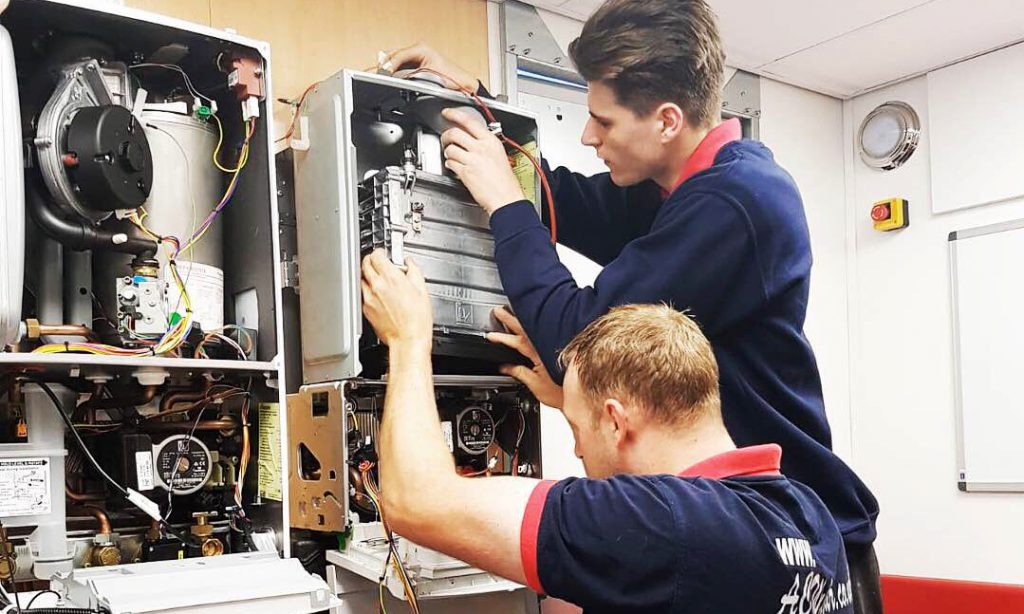 A.C. Wilgar plumbers repairing a boiler