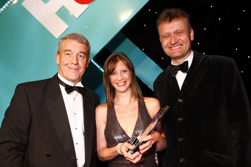 "A.C. Wilgar wins ""Domestic installer"" of the year at H&V News Awards 2011 with Sally Wilgar and Hugh Dennis"